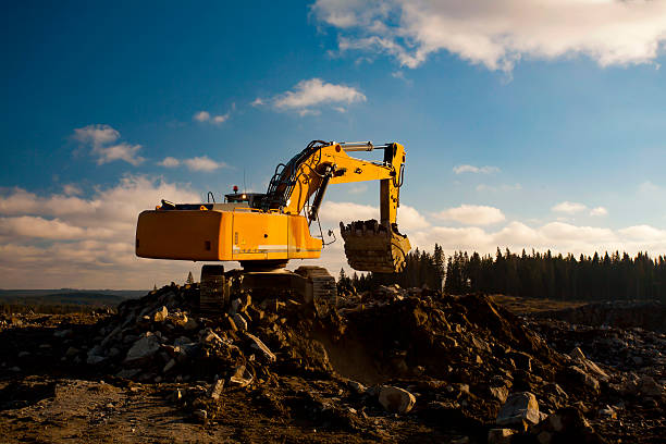 Yellow Excavator with Full Shovel stock photo