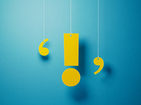 istock Yellow Exclamation Point With String Over Blue Background 1142821887