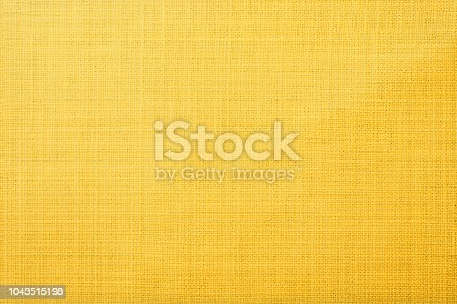 istock Yellow fabric background 1043515198