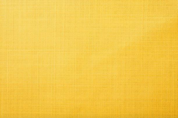 gelbe stoff hintergrund - textilien stock-fotos und bilder