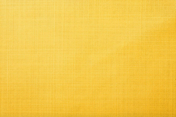 Yellow fabric background Yellow table cloth fabric texture wallpaper background yellow stock pictures, royalty-free photos & images