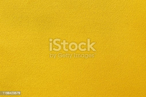 istock Yellow fabric texture background, seamless pattern of natural textile surface. 1156420579