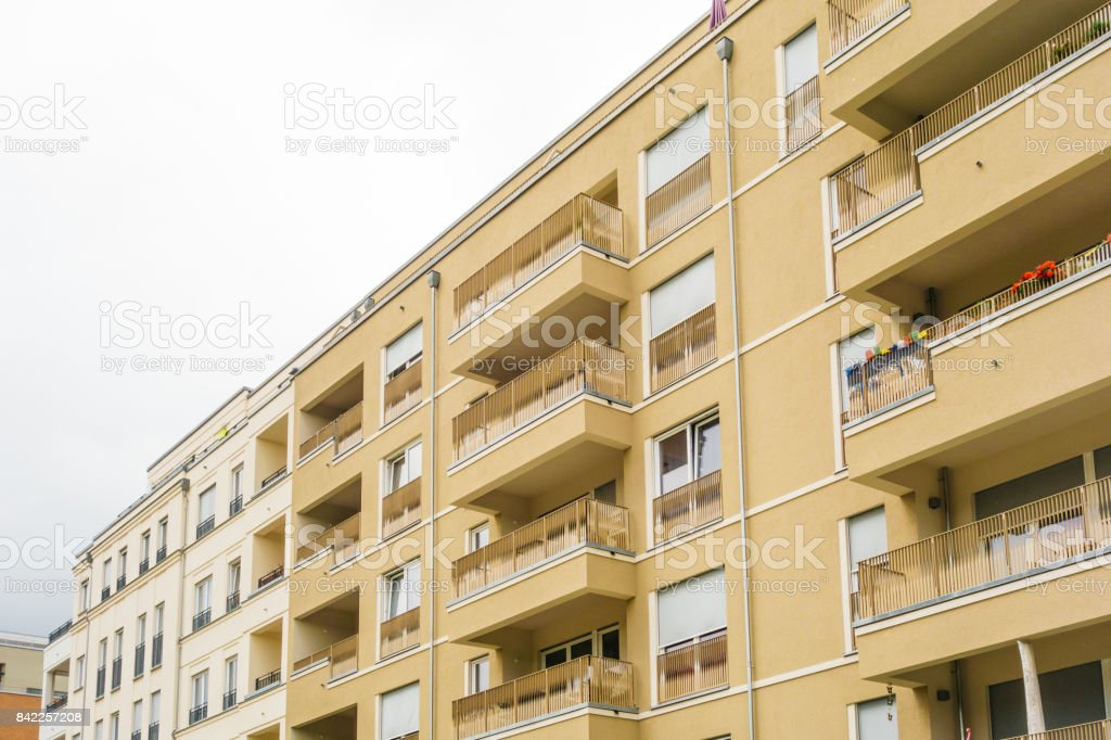 yellow facaded modern apartment building stock photo