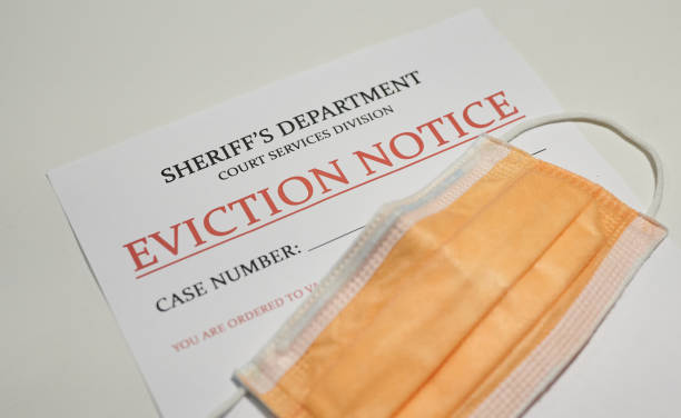 Yellow facial mask laying on top of the eviction note from sheriff's department Yellow facial mask laying on top of the eviction note information sign stock pictures, royalty-free photos & images