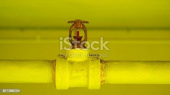 istock Yellow fire sprinkler 821386234