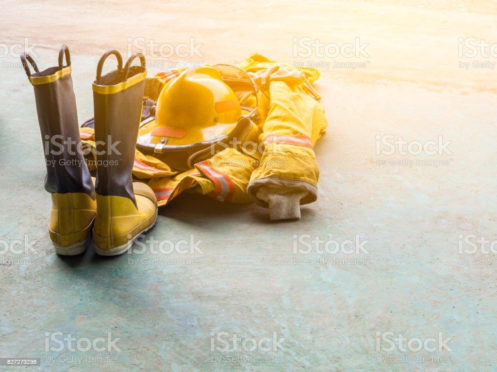 yellow fireproof uniform of Firefighters. On the floor. Flare light. stock photo