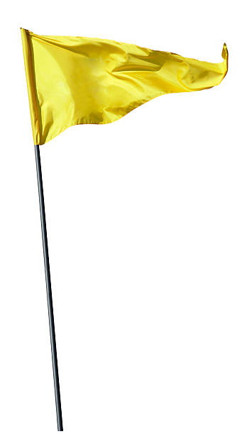 Yellow flag on flag pole blowing in the wind Flag on pole,isolated on white flagpole stock pictures, royalty-free photos & images