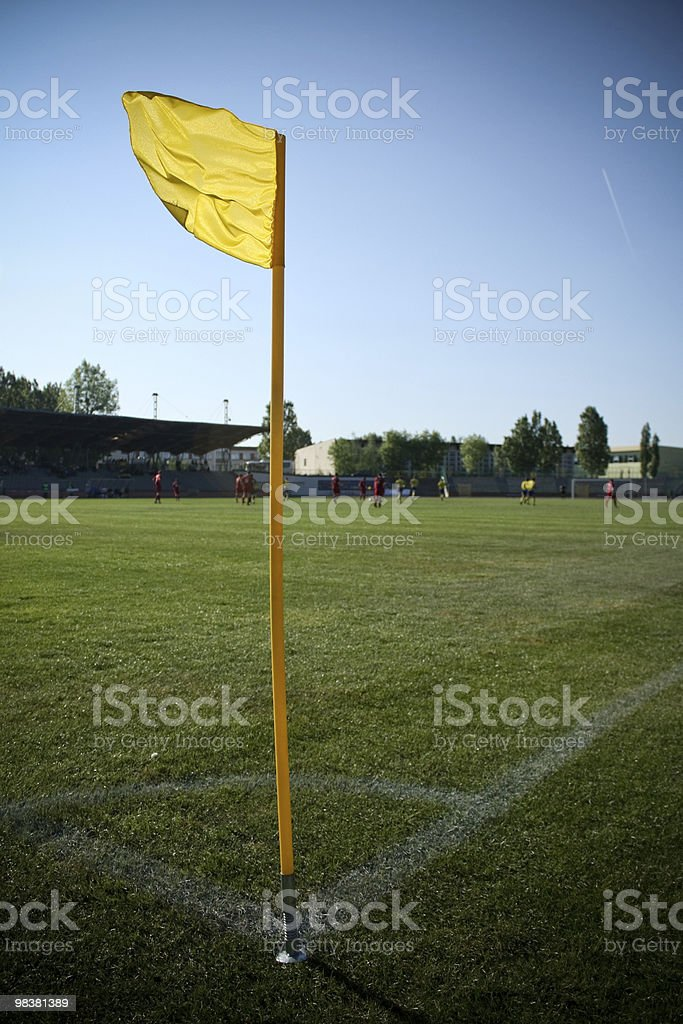Yellow flag on the playing field royalty-free stock photo