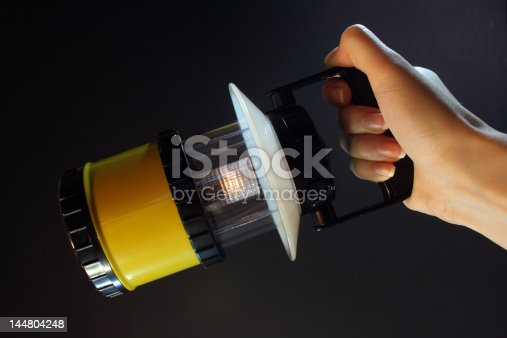 174913696 istock photo Yellow flashlight 144804248