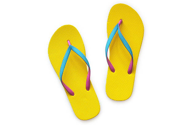 efe55660a Yellow flip flops isolated on white background stock photo
