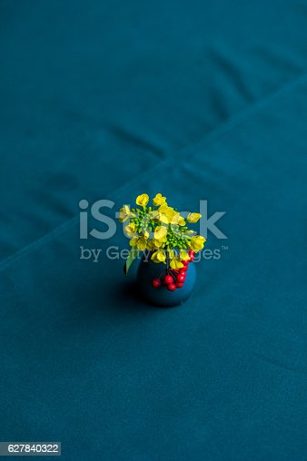 Top view of yellow flower in vase on the table. houseplant decoration