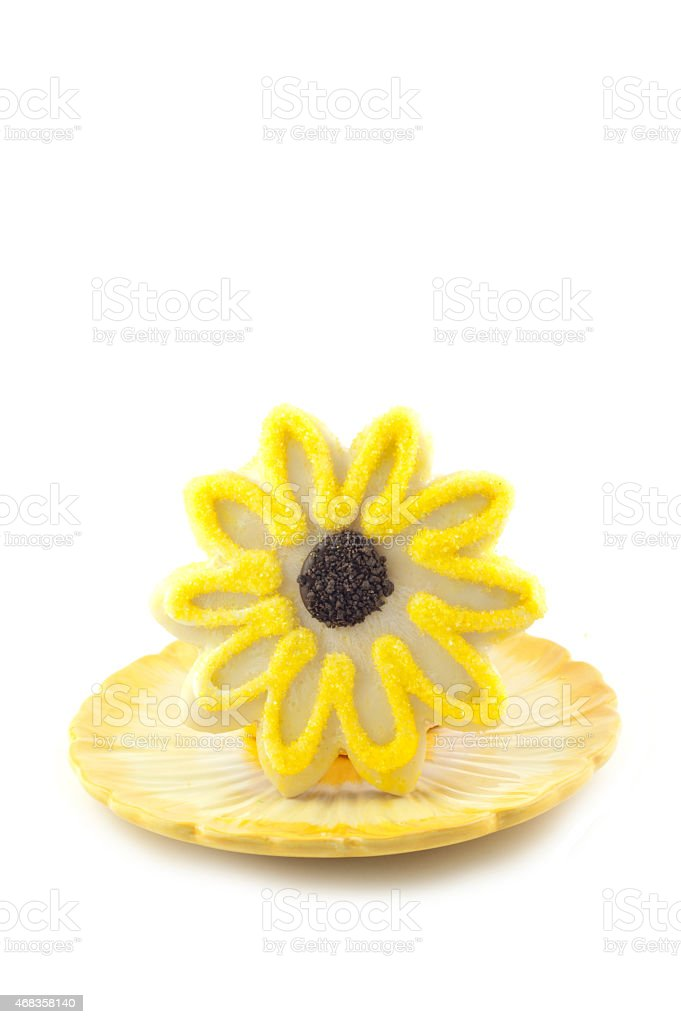 Yellow Flower Sugar Cookie On White Vertical Background royalty-free stock photo