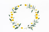istock Yellow flowers and eucalyptus branches. Flat lay, top view 930444418