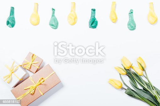 istock Yellow flowers, gift boxes with bows and balloons on white background 655818102