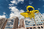 istock Yellow flying taxi against the sky, city electric transport drone. Car with propellers, clean air, fast ride. Mixed media, copy space. 1222566427