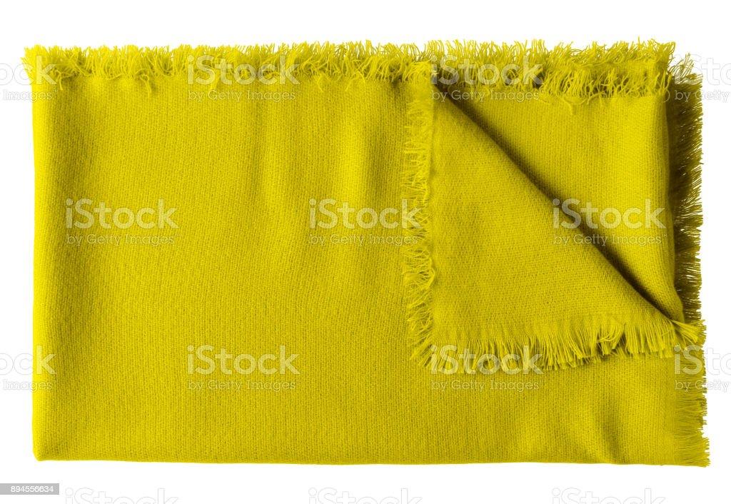 Yellow folded wool shawl blanket isolated on white