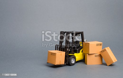1155852718istockphoto Yellow Forklift truck with cardboard boxes. Increase sales, production of goods. transportation, storage of cargo and goods. Freight shipping, delivery of goods. Logistics and infrastructure. retail 1156516896