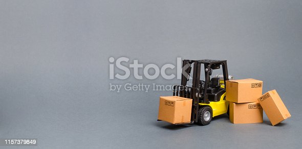 1155852718istockphoto Yellow Forklift truck with cardboard boxes. Increase sales, production of goods. transportation, storage of cargo and goods. Freight shipping, delivery of goods. Logistics. retail. Banner, copy space 1157379849