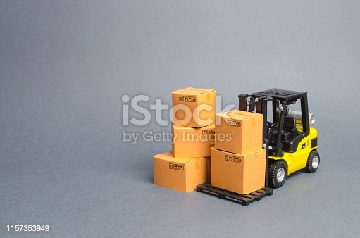 1155852718istockphoto Yellow Forklift truck with cardboard boxes. Service storage of goods in a warehouse, delivery and transportation. Freight shipping, delivery. Import and export, commodity exchange with other countries 1157353949