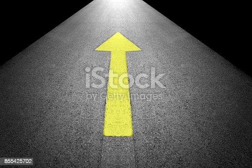 istock Yellow forward arrow sign on grey asphalt road 855425702