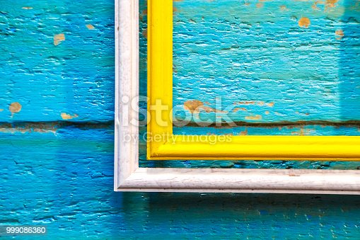 istock yellow frame inside a white frame for photos and images with a blank space inside 999086360
