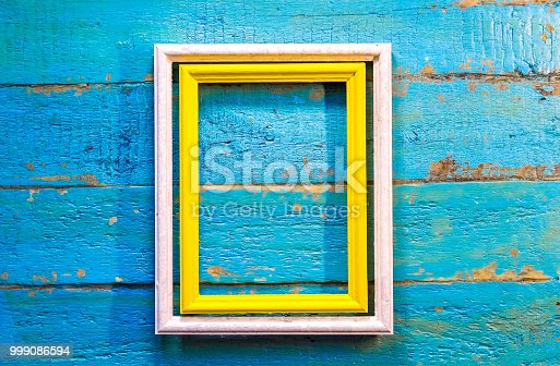 istock yellow frame inside a white frame for photos and images with a blank space inside 999086594