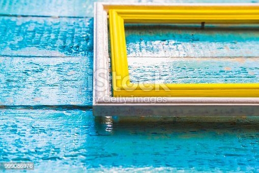 istock yellow frame inside a white frame for photos and images with a blank space inside 999086976