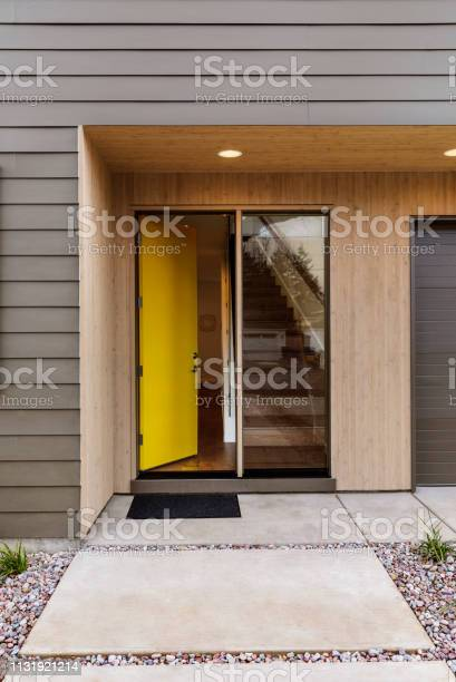 yellow front door of a modern house picture