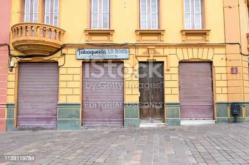 Tenerife, Spain / November 2018. Yellow front - facade of a closed tobacco store in the city center of Santa Cruz de Tenerife.