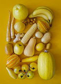 Looking down on monochrome yellow fruits and vegetables