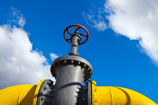 Yellow gas pipe on a sky background