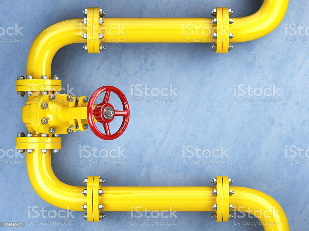 Yellow gas pipeline valve on a blue wall. stock photo