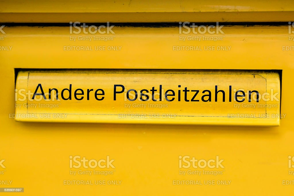Yellow German Mail Box stock photo