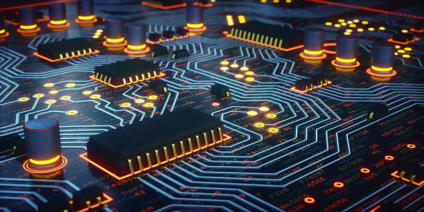 yellow glowing circuit board close-up - mother board stock photos and pictures