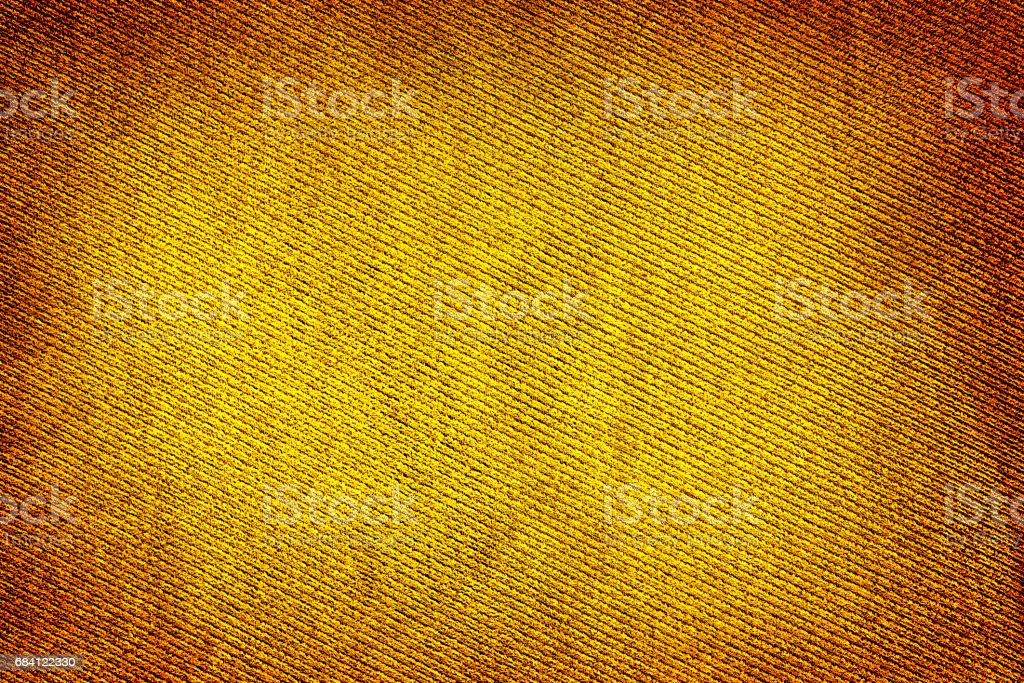 Yellow gold fabric woven texture high contrasted with vignetting effect macro background royalty free stockfoto
