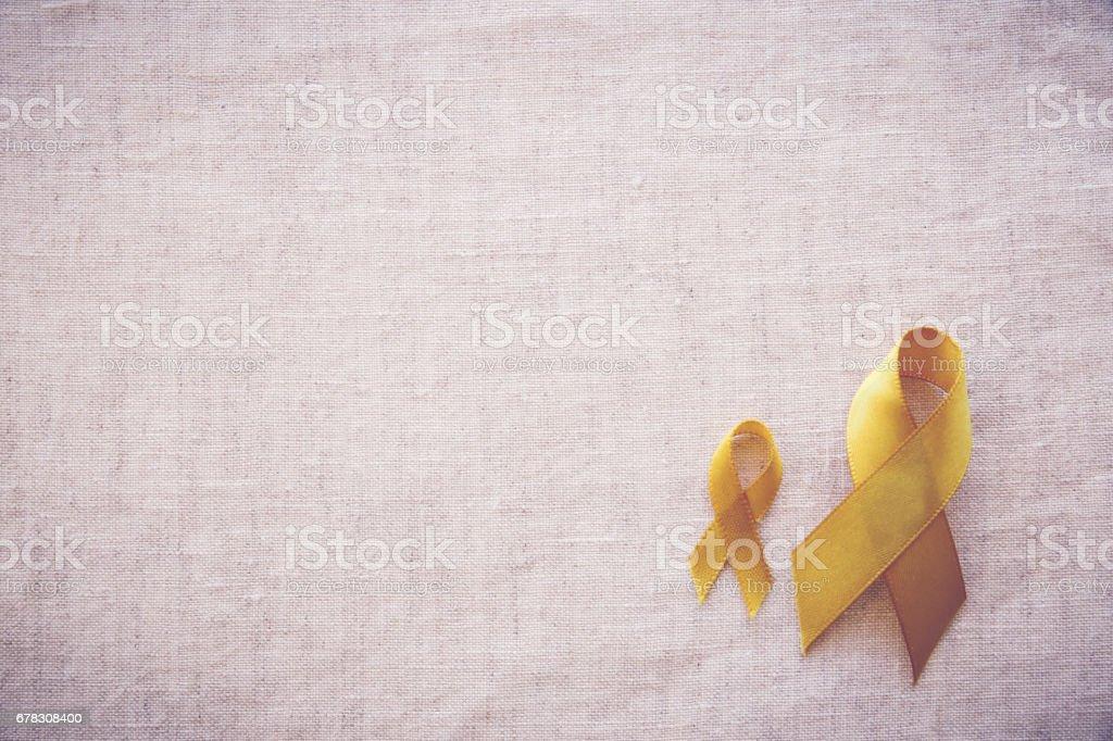 yellow gold ribbons, Sarcoma Awareness, Bone cancer, Liver cancer, Bladder Cancer, childhood cancer awareness stock photo