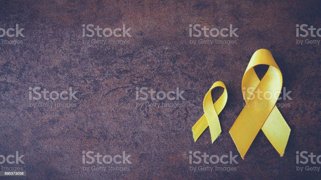 yellow gold ribbons, Sarcoma Awareness, Bone cancer, Liver cancer, Bladder Cancer, childhood cancer awareness, pamoramic banner stock photo