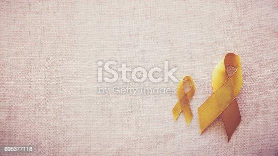 istock yellow gold ribbons, Sarcoma Awareness, Bone cancer, Liver cancer, Bladder Cancer, childhood cancer awareness 695377118