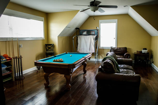 Yellow gold upstairs bonus room with pool table Yellow gold upstairs bonus room done with pool table. Man cave. Recreation room. man cave stock pictures, royalty-free photos & images