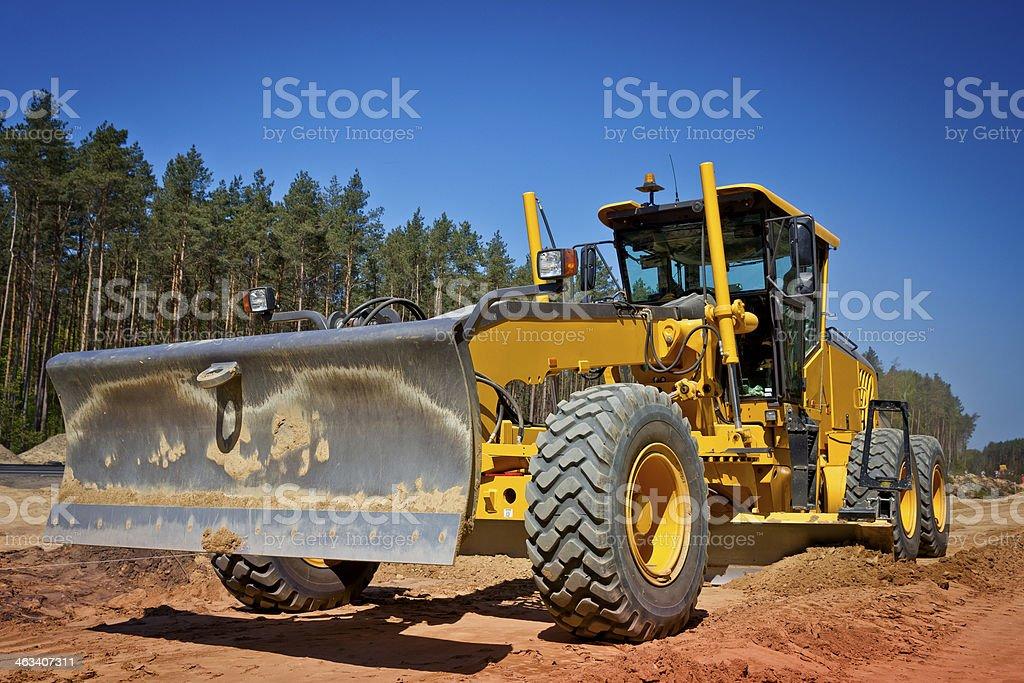 Yellow Grader at a new highway construction stock photo