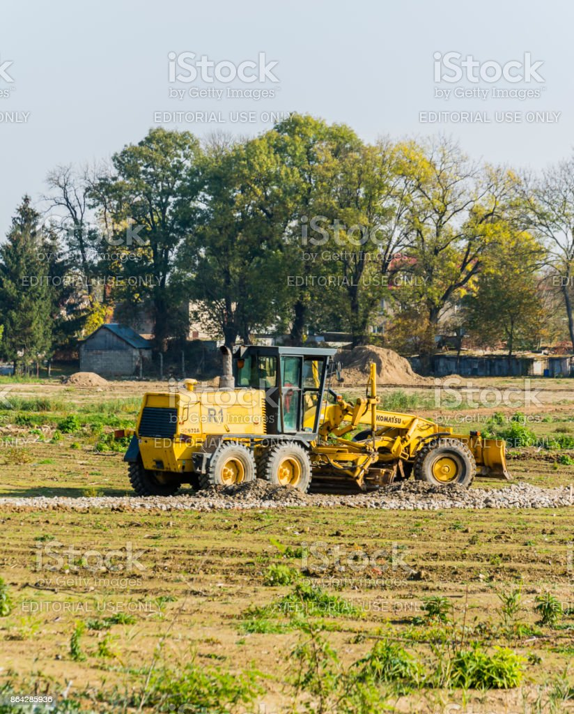 Yellow grader on a construction site. royalty-free stock photo
