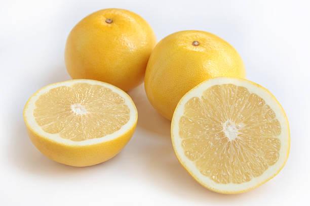 yellow grapefruit - grapefruit stock photos and pictures