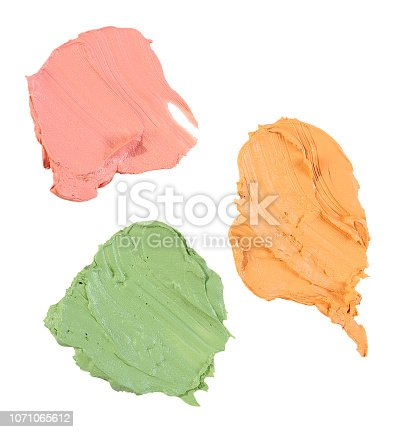 yellow, green and red concealer swatch isolated over white background