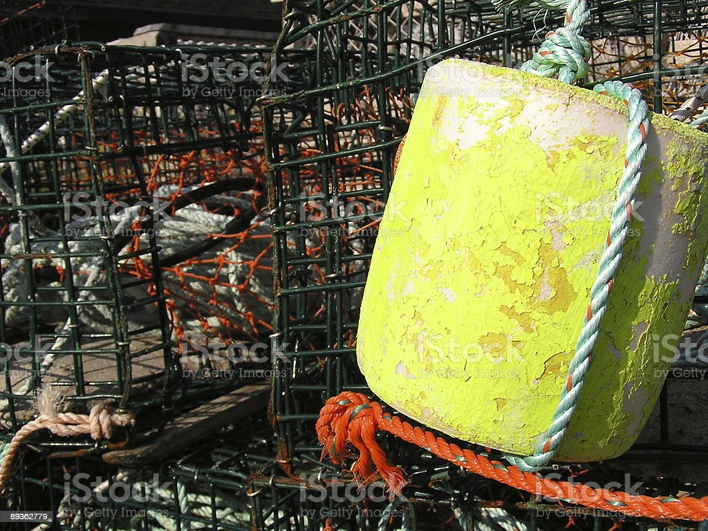 Yellow Green Buoy Among Lobster Traps royalty-free stock photo