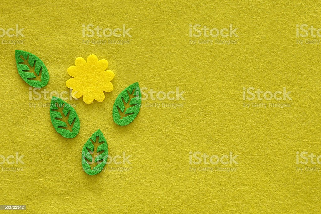 Yellow green textile background from felt with flower and leaves stock photo