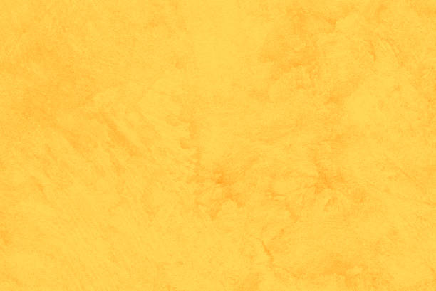 Yellow grunge background Close up on stained cement plaster. Yellow color treatment made with Photoshop. yellow stock pictures, royalty-free photos & images