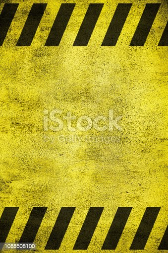 istock Yellow grunge warning sign 1088508100