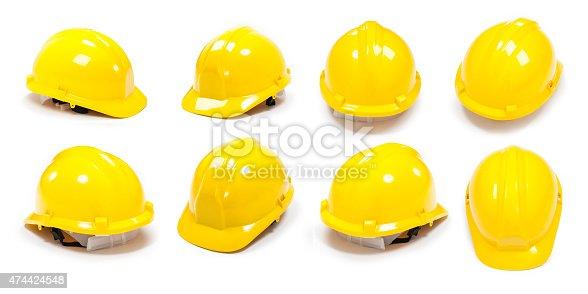 istock Yellow gumboot and protective helmet 474424548
