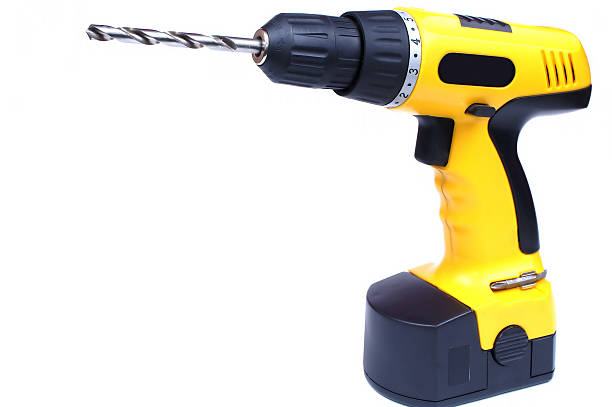 A yellow hand drill isolated on white stock photo