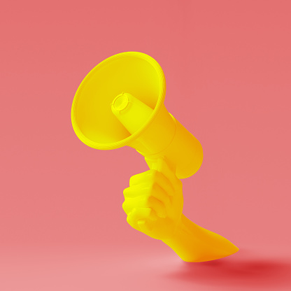 istock Yellow hand holding Megaphone on red background. Isolated loudspeaker announcement and sale creative banner concept. 3d rendering. 1207234849